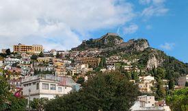 pic of saracen  - Monte Tauro with Saracen Castle and Santuario Madonna della Rocca above Taormina in Sicily - JPG