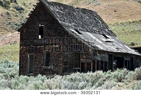 Old Pioneer Homestead In Arid Landscape
