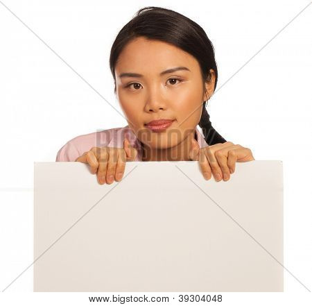 Beautiful Asian woman with a blank white signboard ready for your advertising, text or announcement isolated on white