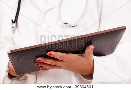 Female doctor holding a tablet computer, isolated over white background.