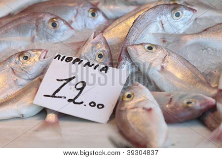 Fish, labelled Lithrinia, on sale in the fish-market at Aegina Town, on the island of Aegina in the Argo-Saronic gulf.