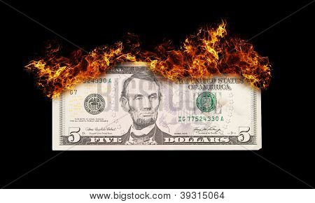 Burning Five Dollar Bill Symbolizing Careless Money Management