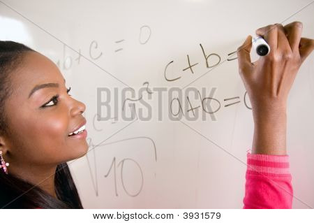 Student Writing On A White Board