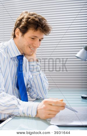 Businessman Reads Document