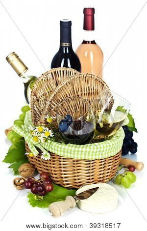 Bottles of wine, grape, french cheese and Picnic basket with glasses