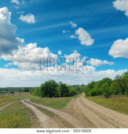 two rural road to horizon under cloudy sky