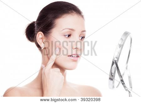 portrait of a happy beautiful woman touching her cheek, isolated against white background