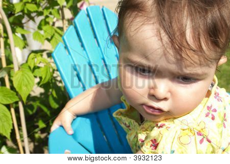 Baby Sitting In A Blue Chair