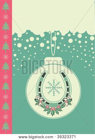 Christmas Card On Snow Background With Ball And Lucky Horseshoe