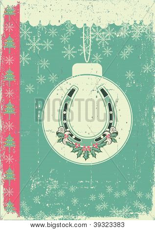 Vintage Christmas Card On Old Paper Background With Ball And Lucky Horseshoe