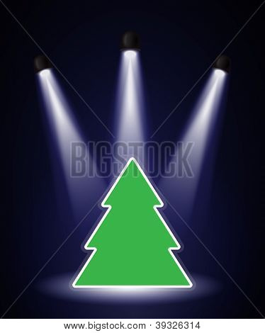 A Christmas tree shape in the spotlight with space for your text. EPS10 vector format.