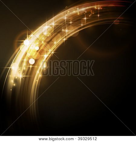 Overlying circle segments with light effects and stars form an abstract golden glowing round border on dark background with a sparkling quality that makes it perfect for the festive Christmas season
