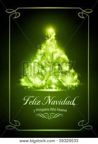 "Warmly sparkling Christmas tree on dark green background of 5x7 inch, with the text ""Feliz Navidad y Pr�?�³spero A�?�±o Nuevo"", Spanish for ""Merry Christmas and a Happy New Year""."