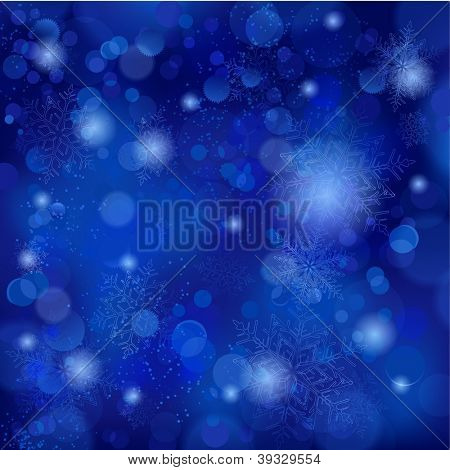 Snowflakes and blurry lights on dark blue background. Great backdrop for winter or Christmas themes. Space for your text.