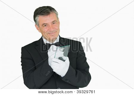 Smiling waiter writing on virtual screen