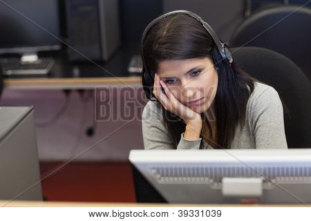 Bored woman in computer room in college