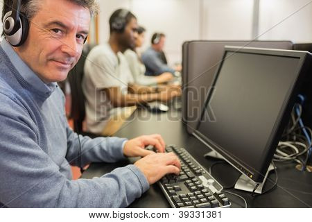 Mature student in computer class in college