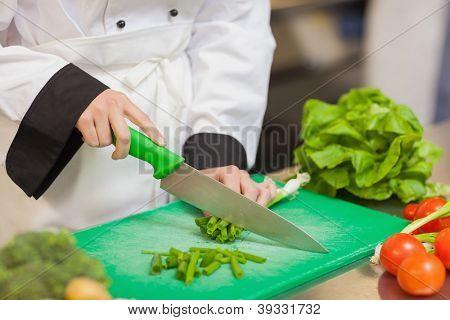 Chef preparing scallion in the kitchen