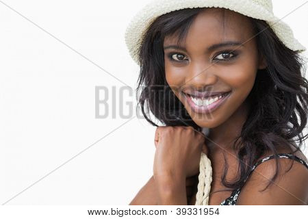 Smiling woman in summer fashion on white background