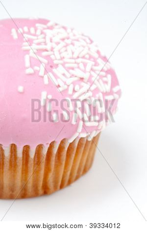 Extreme close up of muffin with icing sugar against a background
