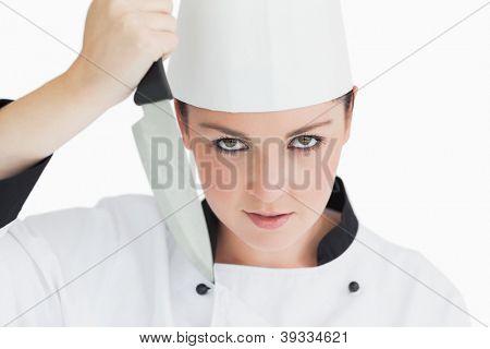 Crazy chef holding sharp knife on white background