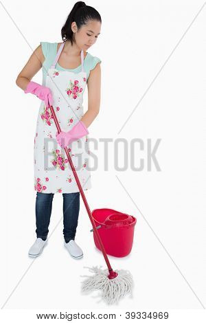 Young woman cleaning the floor with a mop on a white background