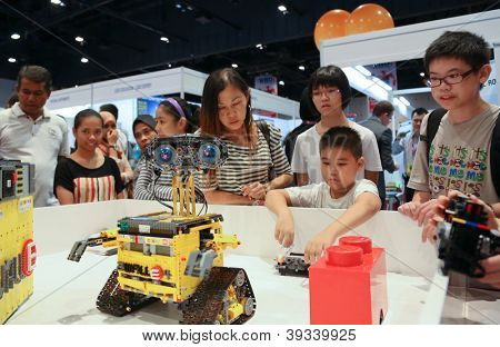 SUBANG JAYA - NOVEMBER 10: Robots perform for unidentified visitors at the World Robot Olympaid on November 10, 2012 in Subang Jaya, Malaysia. This year's theme is Robots connecting people.