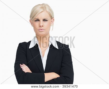 Serious blond businesswoman against white background