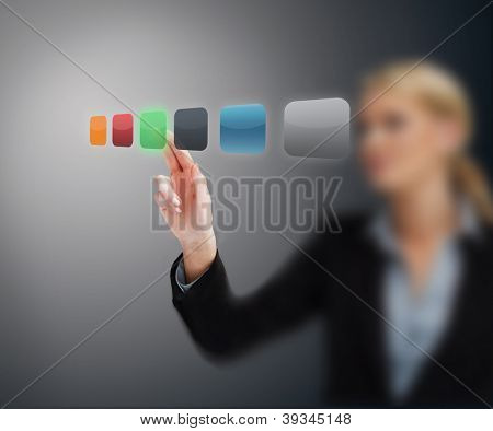Woman selecing green button from hologram touchscreen interface