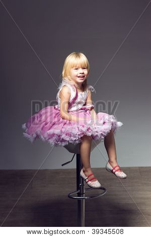 Portrait of a sweet infant wearing a pink tutu