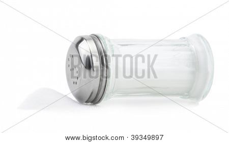 Glass saltcellar with salt on white background