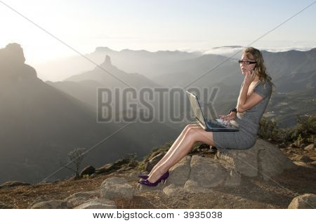 Woman Working With Portatil Laptop In The Mountain