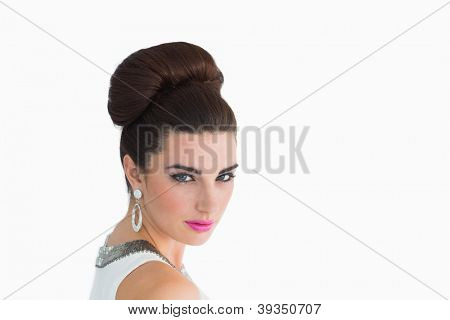 Woman made up in sixtes mod style on white background