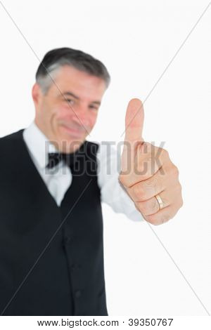 Content man in suit with thumbs up