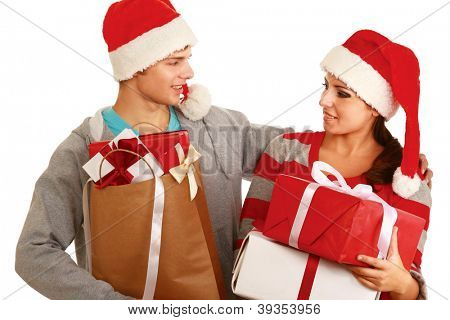 Portrait of young pretty couple holding big red box - christmas gift , isolated on white background