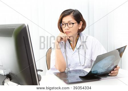 doctor working by watching to computer monitor