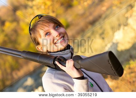 Young Beautiful Girl With A Shotgun