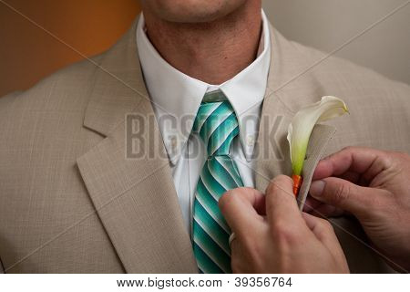 Groom Boutonniere pinning