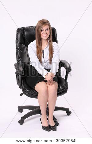 Secretary Sitting In Swivel Chair