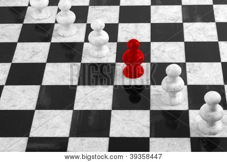 Red Pawn Standing Out In A Group Of White Pawns