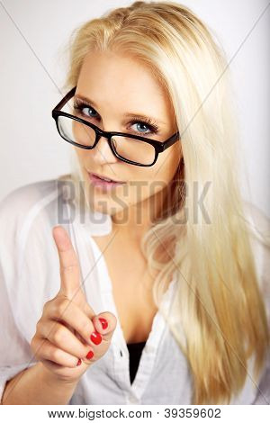 Young Executive Pointing Her Finger Up As A Sign Of Warning