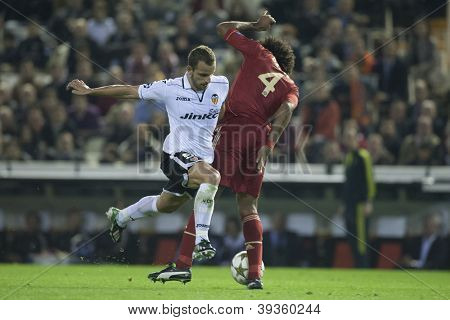 VALENCIA - NOVEMBER 20: Roberto Soldado left and Dante during UEFA Champions League match between Valencia CF and FC Bayer Munchen, on November 20, 2012, in Mestalla Stadium, Valencia, Spain
