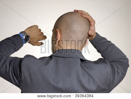 Worry bald head businessman man watching his clock.