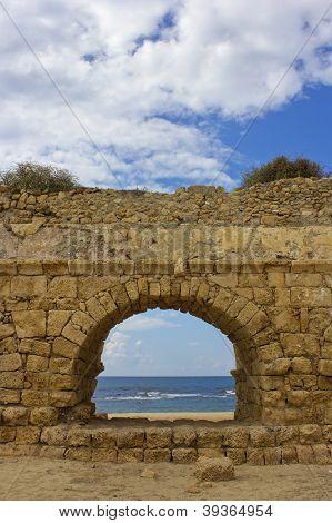 View Of The Mediterranean Sea Through A Stone Arch