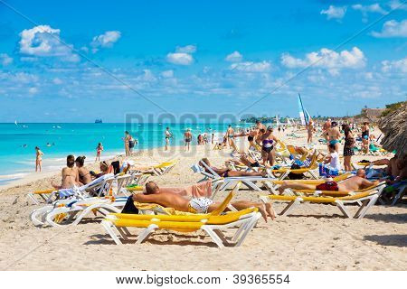 VARADERO,CUBA-NOVEMBER 4:Tourists sunbathing at the beach November 4,2012 in Varadero.With 9% more visitors than last year,Varadero is the main destination for tourists visiting the island
