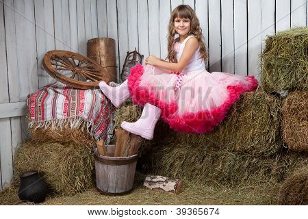 Portrait Of Funny Girl Near Pail With  Apples In Hayloft
