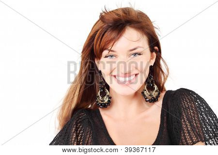 Beautiful girl in black dress and bid earrings smiles isolated on white background.