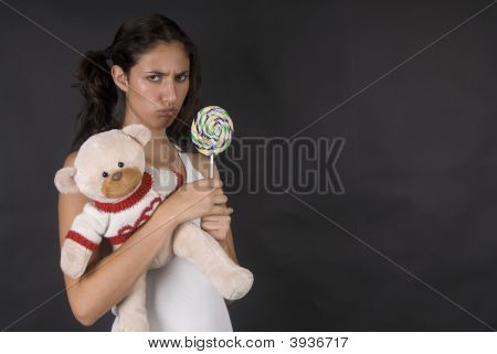 Naughty Girl Eating A Large Lolly Pop