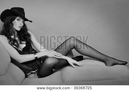 Beautiful brunette leggy girl wearing cowboy hat