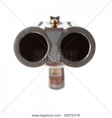 Shotgun aimed at you. Gun control concept. Close up with shallow DOF.